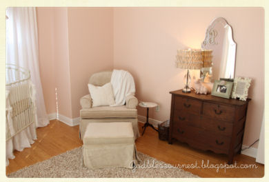 Antique white and pink baby girl nursery with vintage dresser