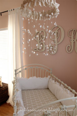 Homemade crystal baby crib mobile with ruffled trim