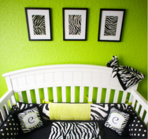 Bright lime green nursery walls with a black crib and custom personalized zebra baby bedding