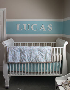 Soft baby blue and brown baby boy nursery room decor with horizontal wall stripes painting technique
