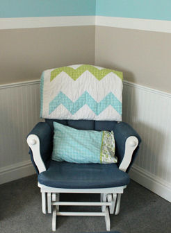 Nursery rocking chair with a (made by Grandma) chevron pattern baby quilt
