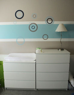 Modern white baby changing table in a baby boy nursery