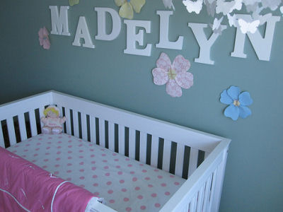 Madelyn's Modern White Baby Crib with Pink and White Polka Dot Fitted Crib Sheet