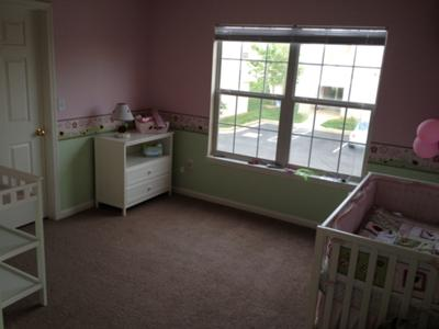 A full view of our baby girl, Makenzey's, bubblegum pink and green ladybug nursery theme