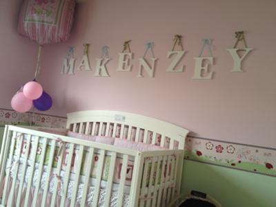 The upper portion of our baby girl's nursery wall is bubblegum pink is separated from the lower third  painted in fresh spring green by a cute ladybug wallpaper border