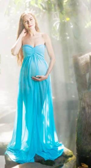 Aqua blue split front long maternity dress for a photo shoot