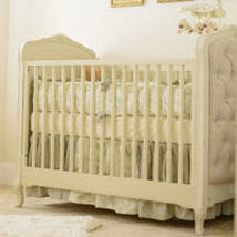 Elegant baby boy nursery room with a Winnie the Pooh theme decorated in neutral colors