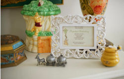 Matthews framed Winnie the Pooh baby shower invition included in a nursery tabletop arrangement