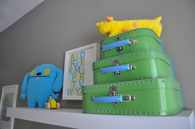 modern baby boy nursery wall decorations shelf arrangement vintage suitcases and doll