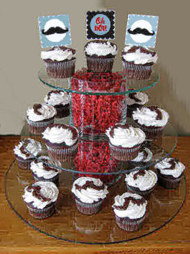 Little man mustache baby shower cupcakes decorated with party circles and frosting mustaches