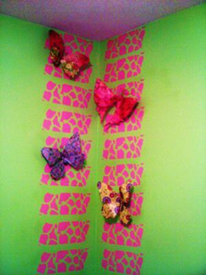 Handmade bandana patterned butterflies decorating my baby girl's nursery walls.