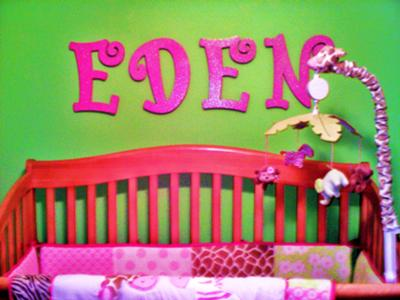 The hot pink, glitter wall letters spell my baby girl's name and provide the ultimate