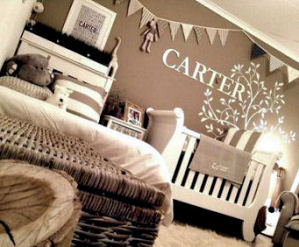 Nature forest theme baby nursery for a boy decorated in earth tones and antique white