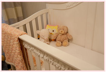 Status Series 200 crib in antique ivory with carved wooden details
