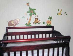 Nojo jungle babies wall decal collection decorating the nursery wall over the crib
