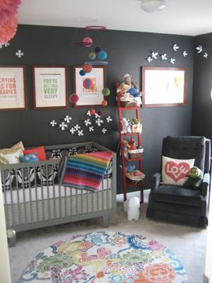 Colorful Baby Girl Nursery w Charcoal Gray Wall - The gray wall color serves as a background that makes the colorful decorations in the room like the homemade baby mobile really POP!