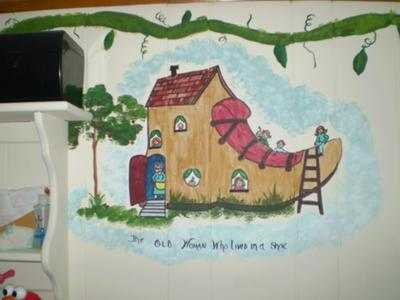 Painting all of the children inside and on top of the shoe in The Old Woman Who Lived In A Shoe segment of the baby's Mother Goose nursery rhymes wall mural required much attention to detail but it turned out beautifully.