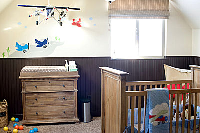 Nursery decorated in a jet airplane theme for a baby boy appropriately named