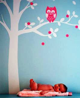 Tree decal with an owl on the branch of a baby nursery wall