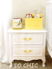 A recycled night stand with bright yellow, painted drawer pulls makes a lovely addition to a baby girl's vintage nursery or shabby chic nursery