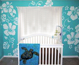 Hawaiian baby nursery theme design with hibiscus flowers painting on the wall and sea turtle baby bedding and applique crib quilt