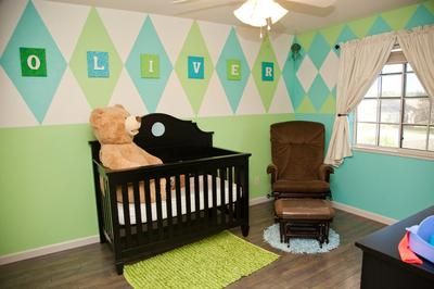 Argyle accent wall in a baby boy sports theme nursery painted with mint green and aqua blue paint