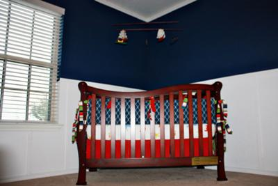 The red, white and blue nautical baby bedding that the baby's grandmother made!