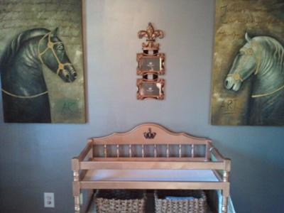 The baby's changing table was customized with gold metallic paint and the nursery walls are painted with silver metallic Martha Stewart precious metals paint.