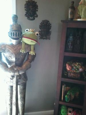 This isn't a frog prince nursery theme but the stuffed, green frog on the shoulder of the knight's armor adds a whimsical touch to the decor.