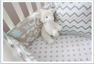 Beautiful taupe and baby blue nursery bedding set in chevron stripes polka dots and modern floral pattern fabrics.