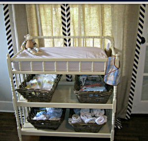 Our Jenny Lind style baby diaper changing table was a garage sale find