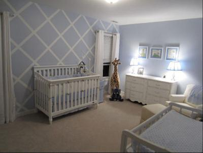 Baby blue and white nursery with a lattice pattern painted on the wall via a DIY painting technique