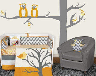 Yellow white and grey chevron owl baby bedding set in a nursery with a tree wall decal