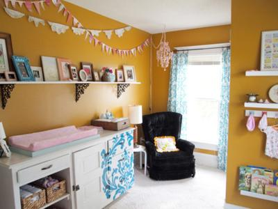 Our girls' nursery walls are mustard yellow color with cheerful turquoise blue and white curtains