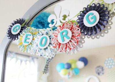 Baby Boy name  banner on the nursery wall made with rosette dies from Lifestyle Crafts