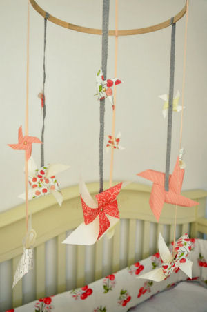 Homemade pinwheel baby crib mobile made with ribbon left over from an Anthropologie bag and scrapbook paper for a baby girl peach cherry nursery room