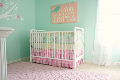 Mom's pink and aqua DIY nursery ideas plus help from loving family members = a baby girl's dream room!