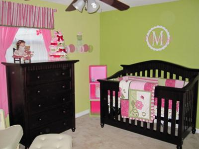 Lime green, hot pink and white baby girl nursery theme.  The pink and green nursery is decorated with frogs, butterflies and flowers accented with striped fabrics and a personalized wall decal that features a monogram with our baby girl's initial, the letter