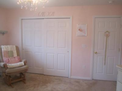 Letters over the nursery closet spell our little princess' name
