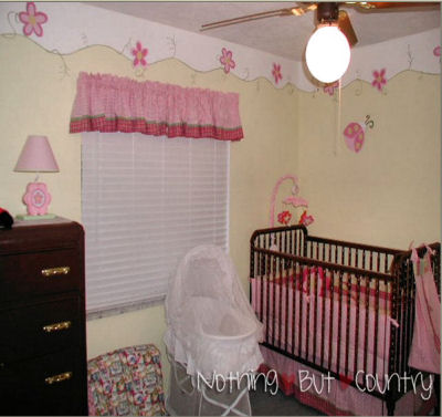 Pastel Yellow and Pink Nursery Decor with Flowers and Ladybugs