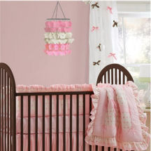Pink and brown baby girl nursery room decorated with DIY crafts projects and curtains