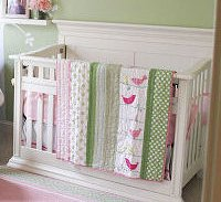 Pink and green baby crib quilt with bird applique patterns