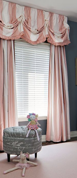 Elegant pink and white striped curtain panels with window valance with pleated edging. Curtain panels with wide pink and white stripes