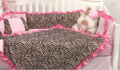 Pink and brown zebra print baby bedding set for a crib in a feminine baby girl nursery room