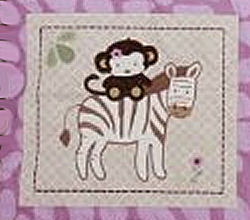 Pink and brown zebra and monkey theme crib quilt for a baby girl nursery room