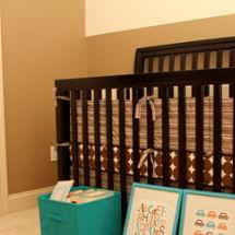 Dwell Studio chocolate dots baby crib bedding set for a baby boy brown aqua blue and orange nursery