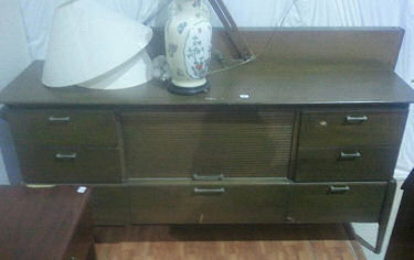 Vintage retro dresser ready found at a thrift store for a baby boy nursery ready to be refinished