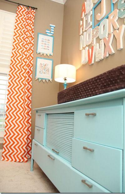 Vintage retro dresser painted aqua blue in a baby boy orange and blue owl nursery