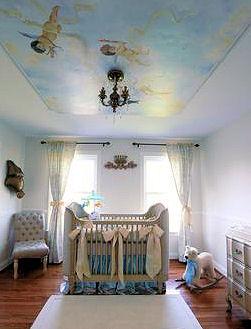 Baby blue boy nursery design with a cherub ceiling mural