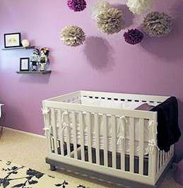 Modern urban style purple and black baby girl nursery with a tattoo theme and crib set